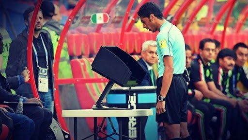 Match referee using on field VAR